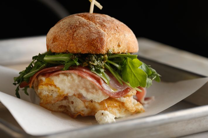 Godmother: Prosciutto, salami, mozzarella, baby arugula, walnut pesto, Pugliese roll.