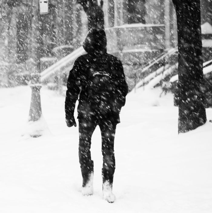 Student walking outside during winter.