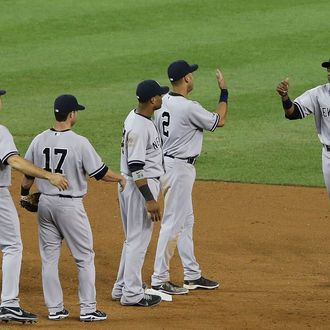 DETROIT, MI - AUGUST 08: Curtis Granderson #14 of the New York Yankees celebrates a win over the Detroit Tigers with his teamates at Comerica Park on August 8, 2012 in Detroit, Michigan. The Yankees defeated the Tigers 12-8. (Photo by Leon Halip/Getty Images)