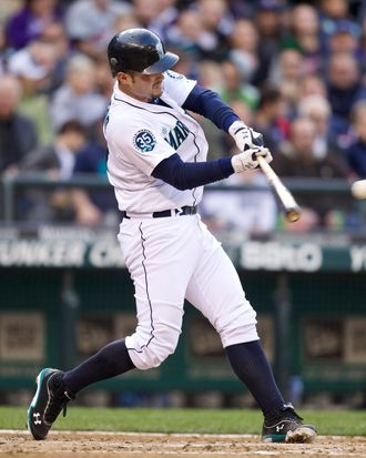 Jesus Montero #63 swings during an at-bat in a game against the Minnesota Twins