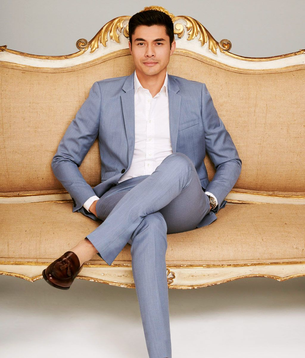 Henry Golding in a suit
