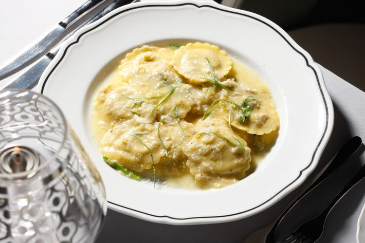 Pancetta-onion-and-Pecorino-filled ravioli with spring-onion butter.