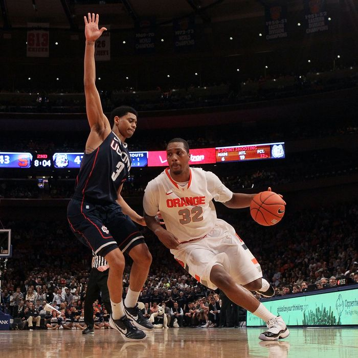 Kris Joseph #32 of the Syracuse Orange handles the ball against Jeremy Lamb #3 of the Connecticut Huskies during the quarterfinals of the Big East Men's Basketball Tournament
