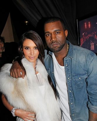 Kim Kardashian and Kanye West attend the Kanye West Ready-To-Wear Fall/Winter 2012 show as part of Paris Fashion Week at Halle Freyssinet on March 6, 2012 in Paris, France.