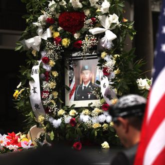 A portrait of Army Pvt. Danny Chen is viewed on a car in his funeral procession in Chinatown on October 13, 2011 in New York City.