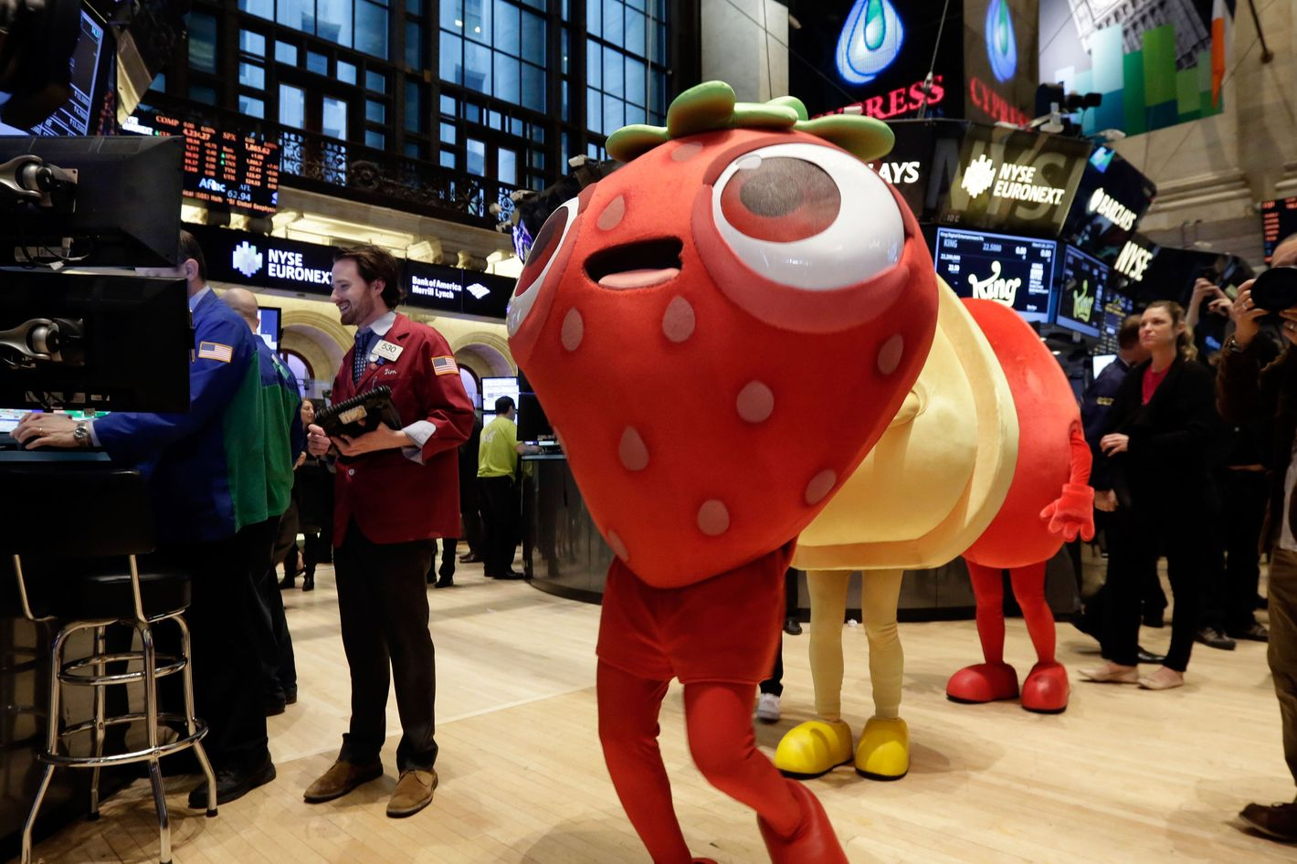 "Characters of the King Digital Entertainment game Candy Crush Saga walk the trading floor of the New York Stock Exchange, before the company's IPO, Wednesday, March 26, 2014.  The stock market opened higher Wednesday after a strong report on American manufacturing. The maker of the hit game ""Candy Crush Saga"" flopped in its market debut."