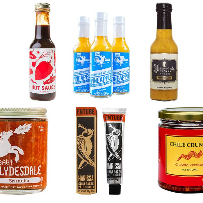 Clockwise, from top left: No. 7 Sub Hot Sauce, Adoboloco Pineapple Hot Sauce, Pirate's Lantern Pepper Sauce, Lao Gan Ma Chili Crisp Sauce, Harissa Entube and Baby Clydesdale Sriracha.