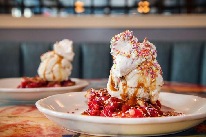 Sour-cherry pie with vanilla ice cream, caramel, whipped cream, and rainbow sprinkles.