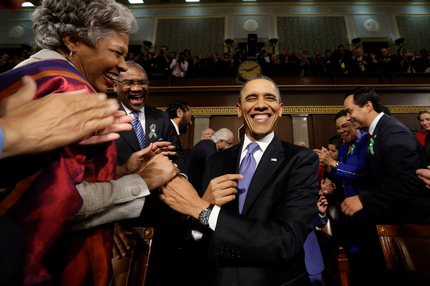U.S. President Barack Obama is greeted before his State of the Union address during a joint session of Congress on Capitol Hill on February 12, 2013 in Washington, D.C. Facing a divided Congress, Obama is expected to focus his speech on new initiatives designed to stimulate the U.S. economy.