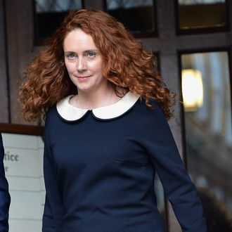 LONDON, ENGLAND - MAY 11: Rebekah Brooks leaves the High Court after giving evidence to the Leveson Inquiry into press standards on May 11, 2012 in London, England. Mrs Brooks, the former Chief Executive of News International and editor of the Sun and News of the World newspapers was questioned on her alleged close links with Prime Minister David Cameron. (Photo by Christopher Furlong/Getty Images)