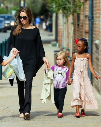 Vivienne Jolie-Pitt and big sister Zahara walk the streets of New Orleans together hand-in-hand.
