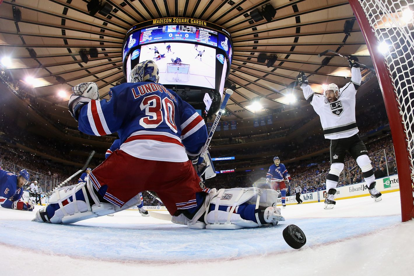 NEW YORK, NY - JUNE 09:  Dwight King #74 of the Los Angeles Kings celebrates a goal on Henrik Lundqvist #30 of the New York Rangers by Jeff Carter #77 of the Los Angeles Kings during the first period of Game Three of the 2014 NHL Stanley Cup Final at Madison Square Garden on June 9, 2014 in New York, New York.  (Photo by Bruce Bennett/Getty Images)
