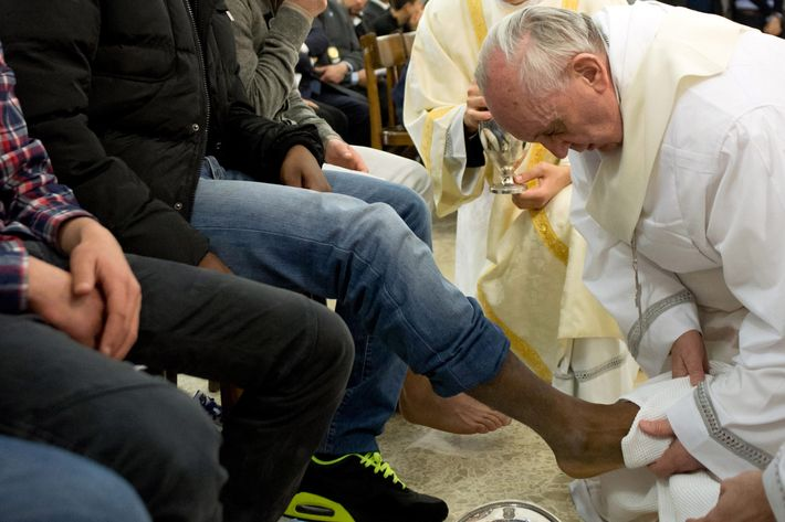 ROME, ITALY - MARCH 28:  (EDITORIAL USE ONLY - STRICTLY NO COMMERCIAL OR MERCHANDISING USAGE - BOOKS OUT, BROADCAST OUT, All image rights and copyrights reserved to the photographic Service of L'Osservatore Romano). IMAGE IS NOT LICENSED FOR USAGE BEYOND 60 DAYS OF CREATE DATE) Pope Francis washes the feet of a  prisoner at the Casal Del Marmo Youth Detention Centre during the mass of the Lord's Supper on March 28, 2013 in Rome, Italy. During the mass, commemorating Christ's Last Supper, Pope Francis will wash the feet of prisoners in the Casal Del Marmo youth detention centre in observance of the Bible's account of Jesus Christ's gesture towards his 12 apostles on the night before he was crucified. (Photo by Servizio Fotografico L'Osservatore Romano via Getty Images)