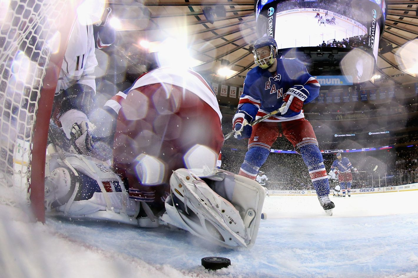 NEW YORK, NY - JUNE 11:  The puck stops just outside the goal behind Henrik Lundqvist #30 of the New York Rangers after a play at the net during the third period of Game Four of the 2014 NHL Stanley Cup Final at Madison Square Garden on June 11, 2014 in New York, New York.  (Photo by Bruce Bennett/Getty Images)