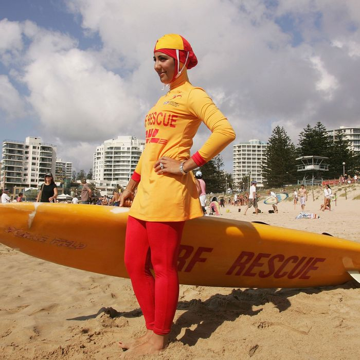 A surfer wearing a burkini in Sydney, Australia.