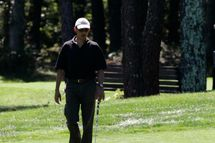 OAK BLUFFS, MA - AUGUST 23: U.S. President Barack Obama plays the first hole of the Farm Neck Golf Club while vacationing on Martha's Vineyard on August 23, 2011 in Oak Bluffs, Massachusetts. This is the third year the president has taken his vacation on Martha's Vineyard. (Photo by Matthew Healey-Pool/Getty Images)