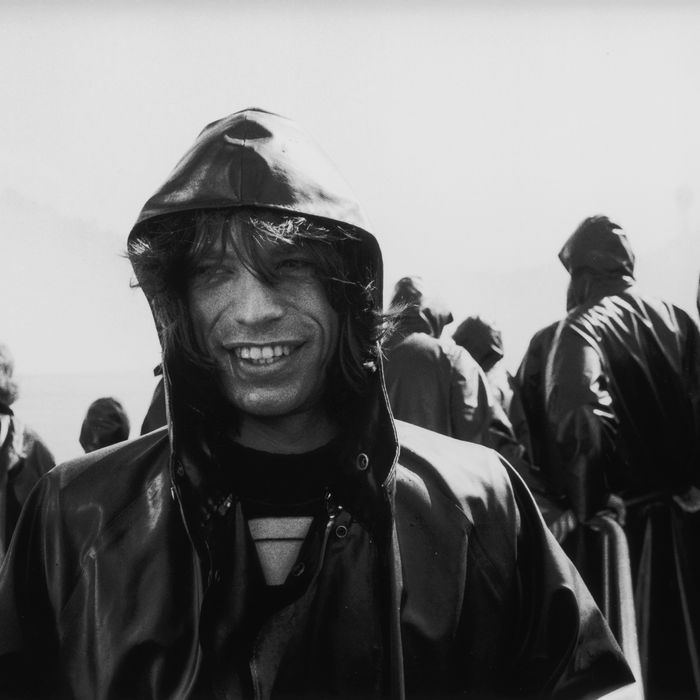 Mick Jagger wearing a rain slicker at Niagara Falls — the Strategist's list of best rain jackets for warm weather, picked by people in the fashion industry.