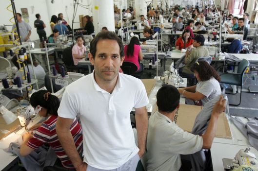 Jul 09, 2010 - Los Angeles, California, U.S. - DOV CHARNEY, CEO of American Apparel and workers at their manufacturing facilities in downtown Los Angeles.  (Credit Image: ? Ringo Chiu/ZUMApress.com)