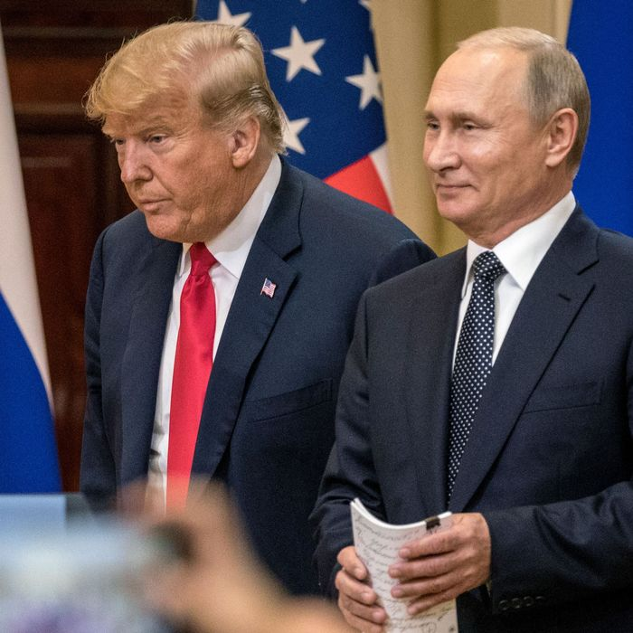 President Donald Trump and Russian President Vladimir Putin arrive to waiting media during a joint press conference after their summit on July 16, 2018 in Helsinki, Finland.