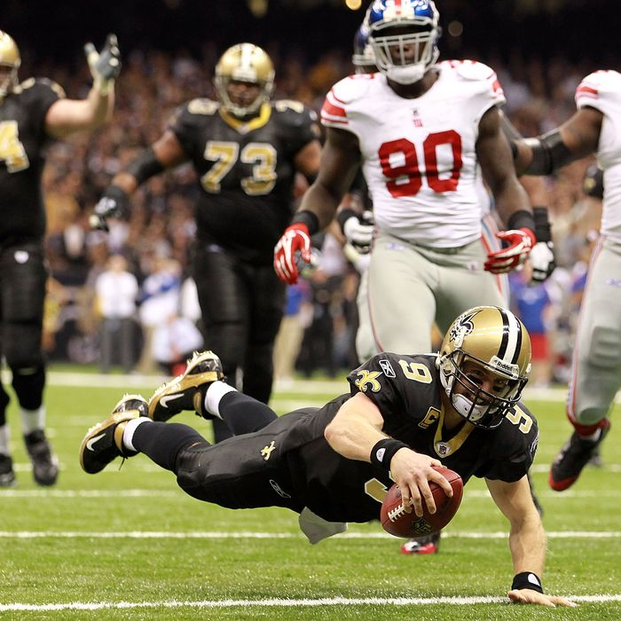 Drew Brees #9 of the New Orleans Saints dives into the endzone for a touchdown against the New York Giants at Mercedes-Benz Superdome on November 28, 2011.