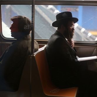 Passengers ride in a subway car in New York City.