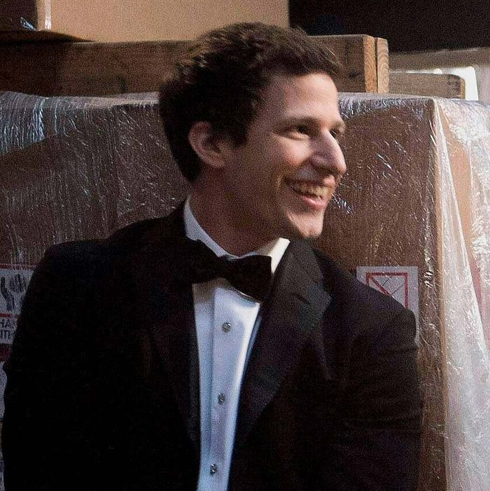 Det. Peralta (Adam Samberg, L) and Det. Santiago (Melissa Fumero, R) get sidetracked chasing a criminal on the day of Gina and Charles' parents' wedding in the