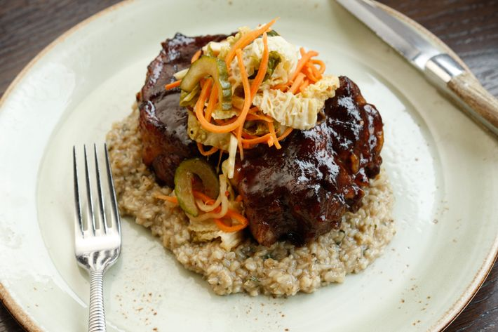 Tamarind-glazed oxtails with pickled cabbage and brown-rice grits.