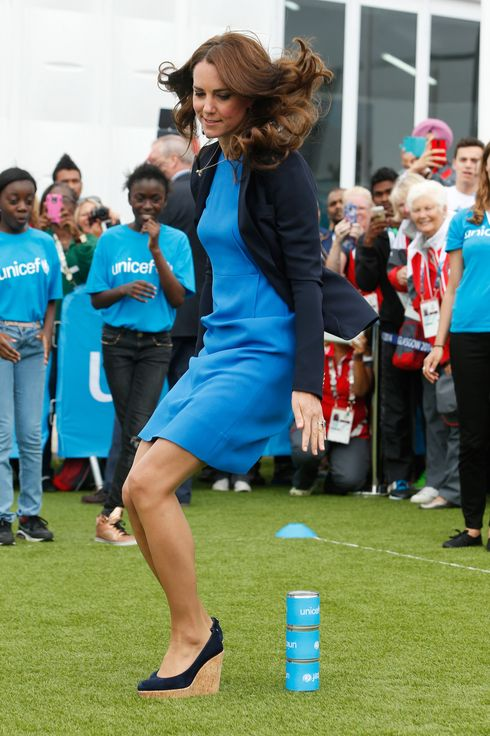 GLASGOW, SCOTLAND - JULY 29:  Catherine, Duchess of Cambridge plays the South African game of Three Tins during a visit to the Commonwealth Games Village on July 29, 2014 in Glasgow, Scotland. (Photo by Danny Lawson - WPA Pool / Getty Images)