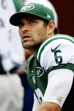 New York Jets quarterback Mark Sanchez (6) looks up from the sidelines during the second half of an NFL football game against the Miami Dolphins, Sunday, Sept. 23, 2012, in Miami.