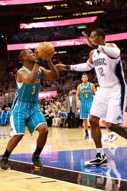 ORLANDO, FL - OCTOBER 10:  Chris Paul #3 of the New Orleans Hornets attempts a shot against Dwight Howard #12 of the Orlando Magic during the game at Amway Arena on October 10, 2010 in Orlando, Florida. NOTE TO USER: User expressly acknowledges and agrees that, by downloading and or using this Photograph, user is consenting to the terms and conditions of the Getty Images License Agreement.  (Photo by Sam Greenwood/Getty Images)
