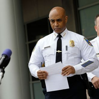 Baltimore Police Department Commissioner Anthony Batts, center, approaches a news conference before announcing that the department's investigation into the death of Freddie Gray was turned over to the State's Attorney's office a day early, Thursday, April 30, 2015, in Baltimore. Standing at right is Deputy Commissioner Kevin Davis. Batts did not give details of the report or take questions. He said the department dedicated more than 30 detectives to working on the case and report. (AP Photo/Patrick Semansky)
