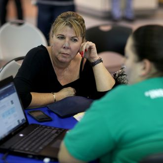 MIAMI, FL - DECEMBER 11: Susana Hernandez (L) speaks with Rosaly Hernandez, an insurance agent with Sunshine Life and Health Advisors, about purchasing insurance under the Affordable Care Act at a kiosk setup at the Mall of Americas on December 11, 2013 in Miami, Florida. As Health and Human Services Secretary Kathleen Sebelius tesified in Washington, DC before a congressional panel that the Affordable Care Act website was improving, the Sunshine Life and Health Advisors said, that they are starting to see a steady increase in the numbers of people coming to them to purchase and understand the policies offered under the Affordable Care Act. (Photo by Joe Raedle/Getty Images)