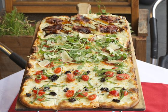 "<b><a href=""http://sanfrancisco.menupages.com/restaurants/tonys-pizza-napoletana/"">Tony's Pizza Napoletana</a></b>    <i>1570 Stockton Street at Union, SF</i>         What we like most about Tony Gemignani's consistently crowded North Beach flasgship, besides his perfect Neapolitan Margherita, is the sheer depth of his menu. He makes nine different regional styles of pizza, including Sicilian, New York coal-fired, St. Louis-style cracker-crusted, Roman pizza by the meter (pictured), and an array of inventive California-Style pies topped with things like Scotch bonnet peppers and rhubarb-apple chutney; quail eggs, potatoes, and guanciale; and his delicious Honey Pie with North Beach honey, Calabrese peppers, Serrano peppers, scallions, mozzarella, pave cheese, and caramelized onions. Where Una Pizza Napoletana's Anthony Mangieri is the ascetic monk in the church of pizza, Gemignani is its exuberant, Universalist high priest, welcoming in all faiths — and even making room for the vegan and gluten-intolerant at the table."