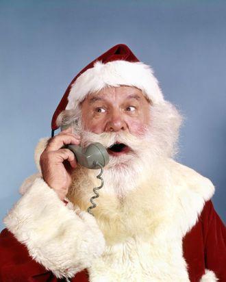 1960s SANTA CLAUS TALKING ON TELEPHONE RETRO