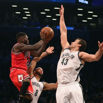 NEW YORK, NY - APRIL 29: Kris Humphries #43 of the Brooklyn Nets blocks Nate Robinson #2 of the Chicago Bulls during Game Five of the Eastern Conference Quarterfinals of the 2013 NBA Playoffs at the Barclays Center on April 29, 2013 in New York City. NOTE TO USER: User expressly acknowledges and agrees that, by downloading and or using this photograph, User is consenting to the terms and conditions of the Getty Images License Agreement. (Photo by Bruce Bennett/Getty Images)