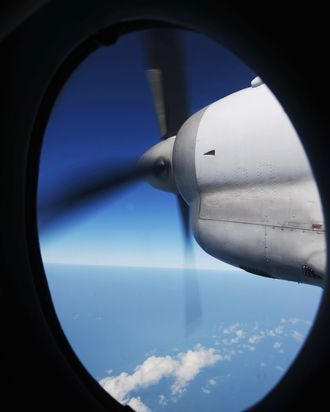 The engine of a Vietnamese Air Force Russian-made AN-27 seen through a window during a search operation over Vietnam's southern sea for missing Malaysia Airlines' flight MH370 on March 14, 2014. The needle-in-a-haystack hunt for the missing Malaysian airliner spread to the vast Indian Ocean after the White House cited
