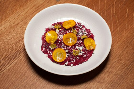 Beetroot risotto, tangy cheese, poppy seed