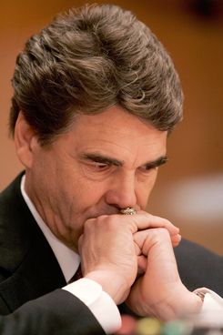 WASHINGTON - MARCH 07:  Texas Governor Rick Perry (R-TX) listens to remarks during a Senate Appropriations Committee hearing on Capitol Hill March 7, 2006 in Washington, DC. The hearing was held to review the president's request for additional resources to assist the Gulf Coast region in its recovery from hurricanes in the Gulf of Mexico in 2005.  (Photo by Mark Wilson/Getty Images)