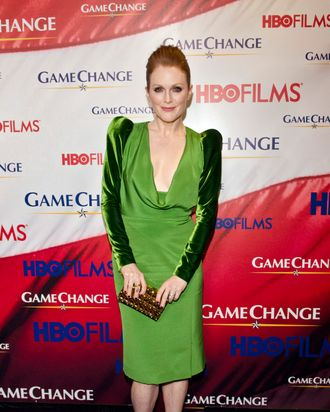 Julianne Moore poses on the red carpet, wearing Tom Ford during the