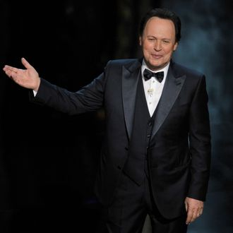 Host Billy Crystal performs onstage during the 84th Annual Academy Awards