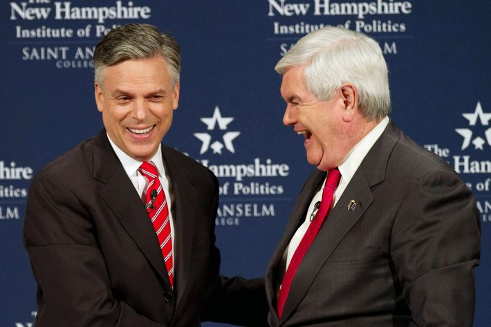 MANCHESTER, NH - DECEMBER 12: Republican Presidential Candidates Newt Gingrich (R) and Jon Huntsman shake hands foloowing a Lincoln-Douglas style debate at Saint Anselm College on December 12, 2011 in Manchester, New Hampshire. The debate will primarily delve into national security and foreign policy.  (Photo by Matthew Cavanaugh/Getty Images)