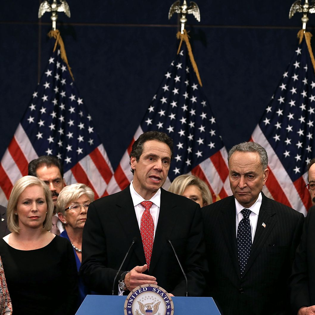 New York Gov. Andrew Cuomo (C) speaks to the media while flanked by members of the New York delegation on Capitol Hill on December 3, 2012 in Washington, DC. Gov. Cuomo visited law makers asking for $42 billion in appropriations for damage caused by Superstorm Sandy.