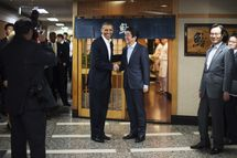 """US President Barack Obama (L) shakes hands with Japanese Prime Minister Shinzo Abe before a private dinner at Sukiyabashi Jiro restaurant in Tokyo on April 23, 2014.   Obama landed in Tokyo on April 23 to launch an Asian tour dedicated to reinvigorating his policy of """"rebalancing"""" US foreign policy towards a dynamic Asia.   Sukiyabashi Jiro's less-than-plush surroundings notwithstanding, it is the proud possessor of three Michelin stars, and people flock to pay a minimum $300 for 20 pieces of sushi chosen by the 88-year-old patron, Jiro Ono."""