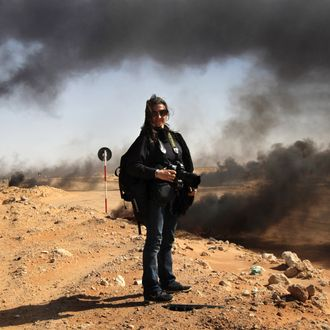 RAS LANUF, LYBIA - MARCH 18: New York Times photographer Lynsey Addario stands near the frontline during a pause in the fighting March 11, 2011 in Ras Lanuf, Libya. Four New York Times journalists, the Beirut bureau chief Anthony Shadid, photographers Tyler Hicks and Lynsey Addario and a reporter and videographer, Stephen Farrell have been missing since March 15, 2011, were reportedly taken by loyalist Libyan forces, and will be released today, March 18. (Photo by John Moore/Getty Images) *** Local Caption *** Lynsey Addario