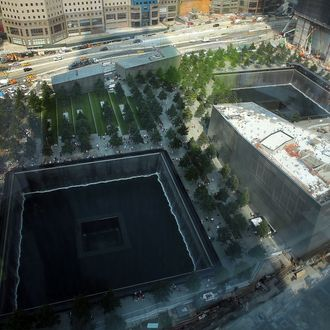 NEW YORK, NY - SEPTEMBER 07: The reflective pool at The National September 11 Memorial Museum is viewed on September 7, 2012 in New York City. As New York City and the country prepare for the 11th anniversary of the September 11, 2001 terrorist attacks, work proceeds at the former site of the World Trade Center Towers. The 16-acre site, which is owned by the Port Authority of New York and New Jersey and is being rebuilt with developer Larry Silverstein, has a projected price tag of $14.8 billion. Of the four office towers planned for the site, two have had finishing beams placed on their top floors and the above-ground memorial was completed in time for the 10th anniversary last year. (Photo by Spencer Platt/Getty Images)