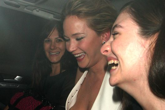 Jennifer Lawrence pops out her dress while laughing in the car with singer Lorde