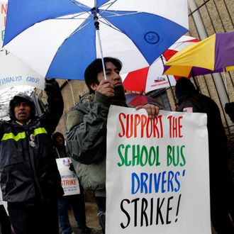 Bus drivers and supporters walk a picket line in front of a bus depot in New York, Wednesday, Jan. 16, 2013. More than 8,000 New York City school bus drivers and matrons went on strike over job protection Wednesday morning, leaving some 152,000 students, many disabled, trying to find other ways to get to school.