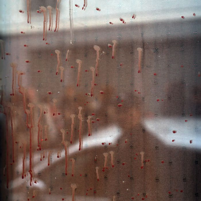 Dried blood can be seen on the window of the Carillon cafe in Paris Saturday Nov. 14, 2015, a day after over 120 people were killed in a series of shooting and explosions.