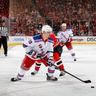 Chris Kreider #20 of the New York Rangers looks to pass against the New Jersey Devils in Game Six of the Eastern Conference Final during the 2012 NHL Stanley Cup Playoffs at the Prudential Center on May 25, 2012 in Newark, New Jersey.