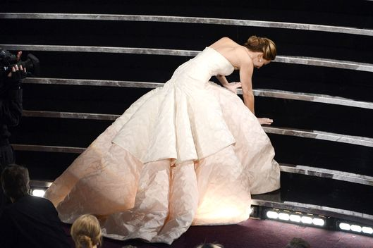 "Actress Jennifer Lawrence reacts after winning the Best Actress award for ""Silver Linings Playbook"" during the Oscars held at the Dolby Theatre on February 24, 2013 in Hollywood, California."